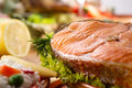 Roasted salmon with lemon soft focus Royalty Free Stock Photos