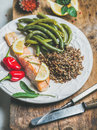 Roasted salmon with multicolored quinoa, chilli pepper and poached beans Royalty Free Stock Photo