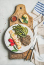 Roasted salmon with multicolored quinoa, pepper and poached green beans Royalty Free Stock Photo
