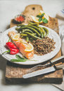 Roasted salmon with quinoa, pepper and poached green beans Royalty Free Stock Photo