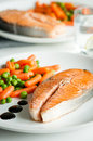 Roasted salmon with vegetable garnish Stock Photos