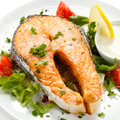Roasted salmon and vegetables fish dish Stock Images