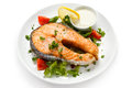 Roasted salmon and vegetables fish dish Royalty Free Stock Photos
