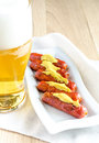 Roasted sausages with glass of beer Royalty Free Stock Photo