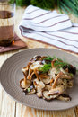 Roasted shiitake mushrooms with onions close up food Royalty Free Stock Photography