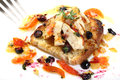 Roasted sliced chicken with tomatoes and blueberries on a dish Royalty Free Stock Photography