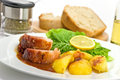Roasted Slices Of Pork With Lettuce And Fried Pota Stock Images