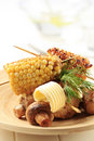 Roasted sweet corn and mushrooms Stock Photos