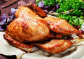 Roasted Turkey. Thanksgiving table served with turkey, decorated with greens and basil on dark wooden background. Homemade food