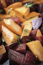 Roasted vegetables beet sweet potato red onion and rosemary with olive oil and seasoning Royalty Free Stock Photo
