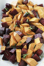 Roasted vegetables beet sweet potato and rosemary with olive oil and seasoning Royalty Free Stock Photos