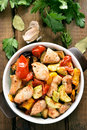 Roasted vegetables with chicken meat in pan Royalty Free Stock Photo