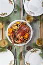 Roasted whole chicken with potatoes and tangerines