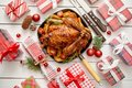 Roasted whole chicken or turkey served in iron pan with Christmas decoration Royalty Free Stock Photo
