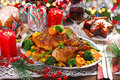 Roasted whole chicken with vegetables on christmas table Royalty Free Stock Photo
