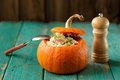 Roasted whole pumpkin with rice and meat with pepper mill select Royalty Free Stock Photo
