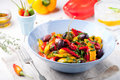 Roasted yellow and red bell pepper salad. Grilled vegetables. Royalty Free Stock Photo