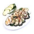 Roasted zucchini on a plate Stock Photo