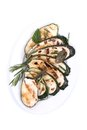 Roasted zucchini on a plate Royalty Free Stock Images
