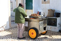 Roasting chestnuts cabo da roca portugal april man sells roasted a customary tradition sold around the country in cabo da roca Royalty Free Stock Image