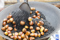 Roasting chestnuts in the pan Royalty Free Stock Photography