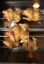 Roasting chicken in the oven Royalty Free Stock Photography