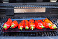 Roasting the chillies on grill Stock Images