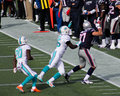 Rob gronkowski pushed out of bounds new england patriots tightend gets by a miami dolphins defender Royalty Free Stock Photos