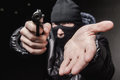 Robber with an aming gun Royalty Free Stock Photo
