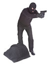 Robber with sack aiming with his gun isolated on white background Stock Photo
