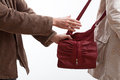 Robber taking a woman purse trying to steal on the street Royalty Free Stock Photography
