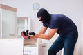 The robber wearing balaclava stealing valuable things Royalty Free Stock Photo