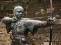 Robin hood statue of the legendary outlaw outside the castle wall in nottingham england Royalty Free Stock Photos