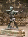 Robin hood statue of the legendary outlaw outside the castle wall in nottingham england Royalty Free Stock Photo