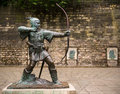 Robin hood statue of the legendary outlaw outside the castle wall in nottingham england Stock Photo