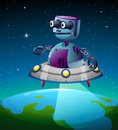 A robot above the earth Royalty Free Stock Photo