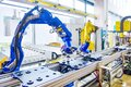 Robot arm robotic hand Robot assembly line automation modern factory workshop Royalty Free Stock Photo