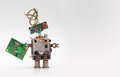 Robot with chip board. Computer accessories toy mechanism, funny head, electrical wire hairstyle, colorful blue red eyes