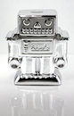 Robot coin bank in white background Royalty Free Stock Images