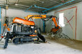 Robot Equipment is destroying the walls of the house Royalty Free Stock Photo