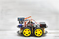 Robot on four wheels and the various conductors Royalty Free Stock Photo