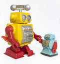Robot friends toy robots holding hands Royalty Free Stock Images