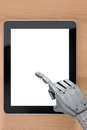 Robot hand using touchscreen tablet blank screen. Royalty Free Stock Photo