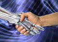 Robot and human handshake.  Friendship between high technology and people Royalty Free Stock Photo