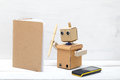 Robot writes a pen in diaries. Artificial Intelligence Royalty Free Stock Photo