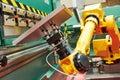 Robotics in hydraulic press brake or bending machine for sheet metal. Royalty Free Stock Photo