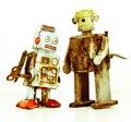 Robots burnt robot toys on white Royalty Free Stock Photo