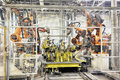 Robots in a car factory see my other works portfolio Royalty Free Stock Photography