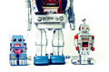 Robots father and kids robot toys on white Stock Photography