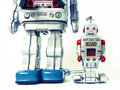 Robots father and son robot toys on white Stock Image